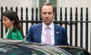 UK health minister 'very sorry' after kiss breaches COVID guidelines